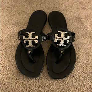 Black Tory Burch sandals with silver logo